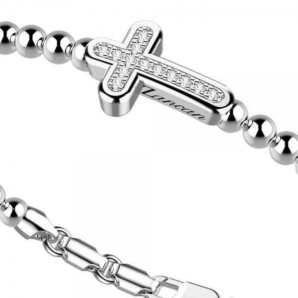 Bracciale in argento con sfere e croce di zaffiri bianchi.