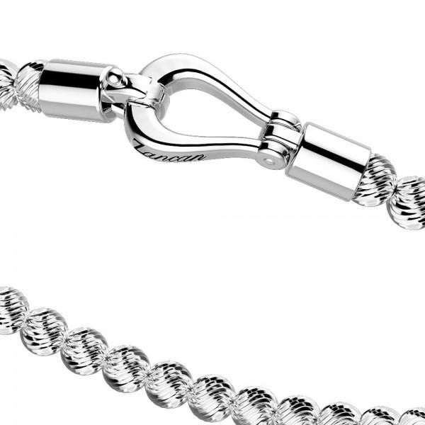 Bracciale in argento con sfere striate e chiusura gioiello.