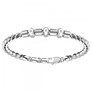 Bracciale in argento con sfere e zaffiri bianchi su bulloni.