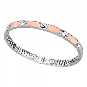 Rigid bracelet in rose gold and silver.