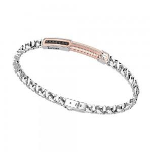 Bracciale in argento con inserto in oro e pietre.