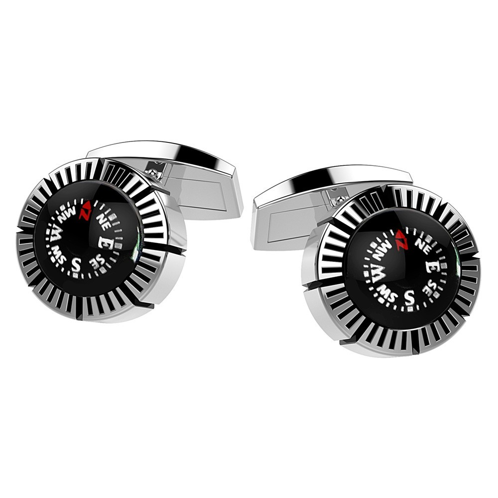 silver cufflinks with compass with black background.