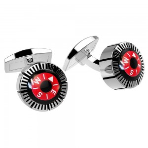 silver cufflinks with compass with red background.