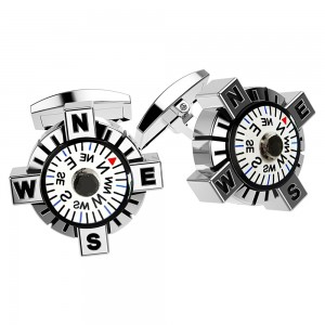 silver cufflinks with compass with white background.