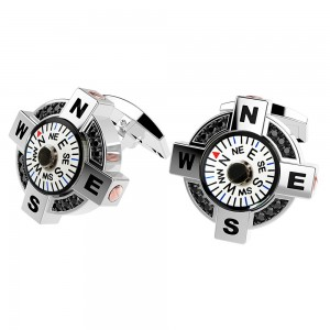 silver cufflinks with compass with white background, black spinels and pink gold details.